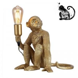 lampe singe dorée