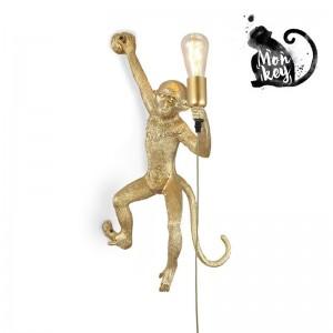 lampe murale singe doré