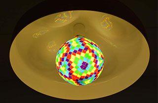 lampara nordica encendida con bombilla led barcelona de estilo gaudiniana